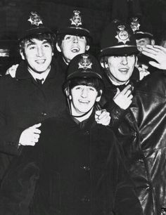 The Beatles in police helmets