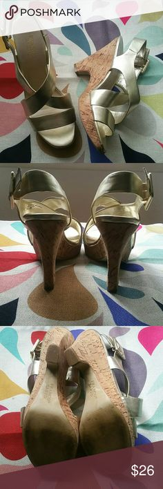 """Franco Sarto Gold Metallic Wedge Sandals Franco Sarto gold metallic wedge sandals. Excellent condition, worn 2-3 times. All man made materials, padded footbed, very comfortable. Heel measures 4"""" at highest, with 1"""" wedge at ball of foot. Smoke-free home. Franco Sarto Shoes"""