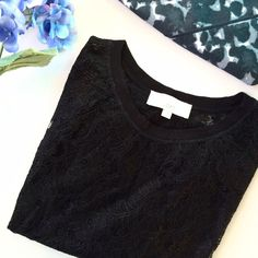 Black lace top Black sheer lace top. Lace part is nylon. Lining at the collar, sleeves, and bottom is cotton. New without tags! LOFT Tops