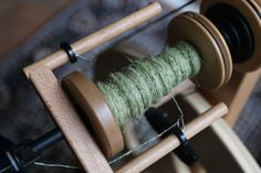 I'm spinning into thread the nettle fibers that nature grew and I harvested this summer. (Head over here if you want to read Part I about harvesting and processing stinging nettle fiber.) What I ha...