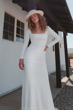 Jenny Yoo's Sabel wedding gown NEW for Fall/Winter 2021 is modern yet timeless. The Sabel dress features a stunning square neckline, fitted long sleeves, and a sleek fit and flare skirt. Cut in our incredibly flattering knit crepe fabric, this gown is as easy to wear as it is elegant!