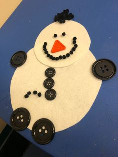 A fun activity for the kids to make snowman using felt and buttons
