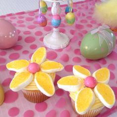 Easy flowers, egg shaped marshmallows, cut, dip in sugar. Center gum ball.