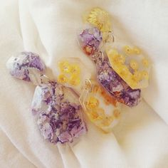 Purple Hydrangeas and Yellow Paper Daisies embedded in clear resin Earrings! follow rosaleenryan on Instagram for updates!