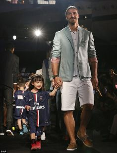 Mascot: The PSG players were accompanied by young fans in the club's home kit as they walk. I Am Zlatan, Soccer Kits, Man Bun, Ac Milan, Fashion Mode, Your Girlfriends, Best Player, Psg, Ugly Sweater