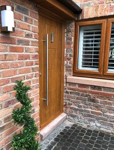 An industry-leading manufacturer of tailor-made composite doors, stable doors and french doors with unmatched strength and security. Oak Front Door, Back Doors, Composite Door, Light Oak, Stables, Garage Doors, Barn, Industrial, Outdoor Decor