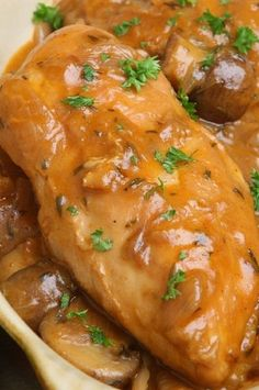 Slow cooker chicken in mushroom gravy. This is very easy and delicious chicken recipe. Chicken breasts with creamy mushroom soup, dry white wine, and mushrooms cooked in a slow cooker. #slowcooker #rockpot #chicken #dinner #mushroom #gravy Creamy Mushroom Soup, Mushroom Gravy, Slow Cooker Recipes, Meat Recipes, Crockpot Recipes, Yummy Chicken Recipes, Yum Yum Chicken, Stuffed Mushrooms, Chicken Mushrooms