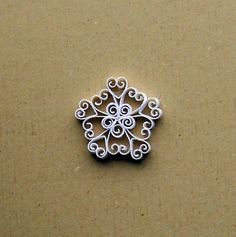 My tiny quilled snowflake.