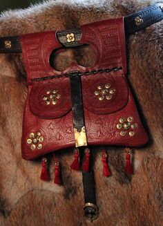 handmade girdle purse made for Marquart von Sternberg. 1370s (leather, brass, silk, citrine, garnet)