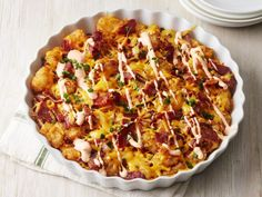 Cheesy Bacon-Tater Tot Pie recipe from Food Network Kitchen via Food Network(Bacon Cheese Steak) Hamburger Tater Tot Casserole, Best Chicken Casserole, Tater Tot Breakfast Casserole, Bacon Breakfast, Casserole Recipes, Breakfast Ideas, Cheesy Tater Tots, Loaded Tater Tots, Breakfast Potatoes