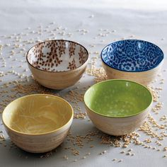Molded from nature. An organic-looking version of west elm's Modernist Bowls, these four petite porcelain pieces are made in Japan using a special technique that allows the floral, leaf and botanical and branch patterns to be perfectly printed on the interior of each. With a beautifully sculpted exterior that echoes textured tree bark, these pieces are ideal for trinkets and treasures or snacks and cereal.