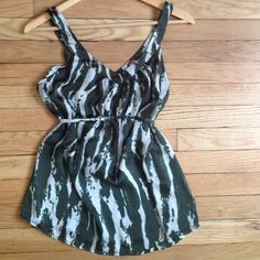 """F21 Green & Off-white Print Cami with Tie, small F21 Green & Off-white Print Cami with Tie, gathering at Vneck. Can be tied in front or back. 100% polyester. Size small, 17.5"""" armpit to armpit, 24.5"""" shoulder to hem. Perfect condition. No trades, bundle discount available! Forever 21 Tops Tank Tops"""