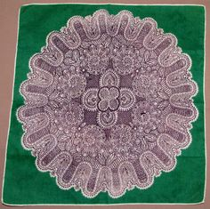 Green hankie with brown and white medallion
