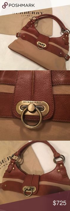 """Burberry Nova Check Leather Handbag Burberry leather and tan canvas handbag. Gold hardware and buckle detail on side. Interior is classic nova check pattern and has 3 pockets. L 16"""" x H 8 1/2 x W 6"""". Strap drop 9"""". Measurements are approximate. Original dust bag included. In excellent condition. No stains or marks. Reasonable offers accepted. No trades. Posh Concierge will verify authenticity. Shop with confidence!  Flaw: Gold hardware has minor scratching from normal use. Burberry Bags…"""
