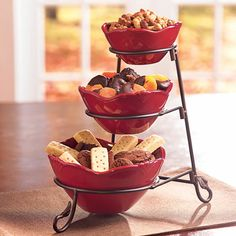 This set takes advantage of vertical space to save room on your table.NESTING SERVING BOWLS & HOLDER SET: Set includes the Nesting Serving Bowls (6857; also sold separately) and a vertical metal holder $59.95 Contact Me With Your Order lavinazimmerman@myprincesshouse.com
