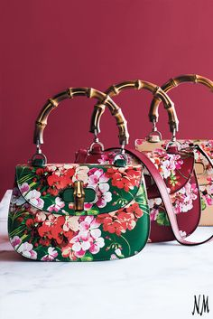Gucci returns to its heritage with this Bamboo Classic Blooms handbag. Carry this with a colorful ensemble and eclectic jewelry for a bold look.
