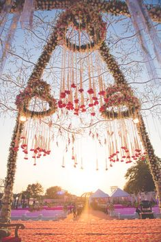 Floral chandeliers suspended from mandap