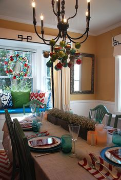 Mimic this bright palette for your dining room Christmas decorations! Using teal, red and mint green is a fun twist on a classic palette of red and green.