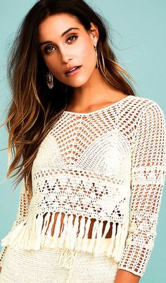 Make your mark on the festival scene with the Mink Pink Henna Cream Crochet Crop Top! Cream crocheted cotton starts at a bateau neckline, and falls to long sleeves, and a relaxed, cropped bodice with knotted fringe. Crochet Long Sleeve Tops, Crochet Crop Top, Long Sleeve Crop Top, Crochet Tops, Black Crochet Dress, Crochet Skirts, Crochet Clothes, Sweater Knitting Patterns, Knitting Sweaters