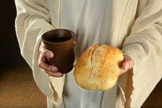 Jesus Holding Bread y vino Imagen de archivo libre de regalías