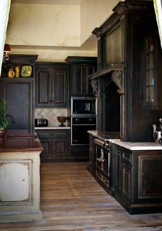 Black glazed cabinets! I'm obsessed!!  I'm doing this to my plan oak ones, let's hope it turns out like this!