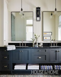 This principal ensuite has a simple, casual look with dark grey cabinetry and hammered-nickel hardware. | Photographer: Stacey Brandford | Designer: Sarah Richardson Design