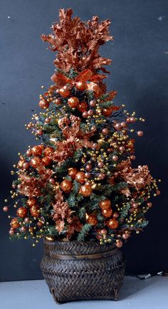 Christmas Copper Tree all decked out with glittered copper bulbs and 150 white lights in a bamboo basket.  This is a Christmas tree to brighten up your home decor and a special Christmas gift