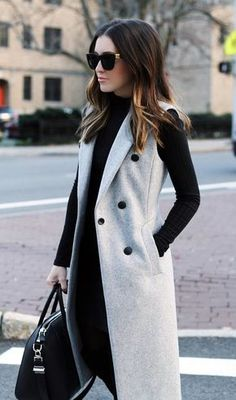 Smart - sleeveless jacket with column of colour elsewhere (long sleeve top and trousers), trainers or heels
