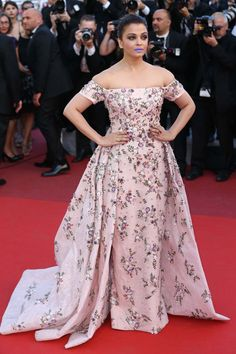 """2016 Cannes - Aishwarya Rai, India, in Rami Kadi - A Cannes O.G., if you will, Rai—often dubbed """"The Most Beautiful Woman in the World""""—has a knack for taking the Cannes red carpet by storm with her unerring commitment to extravagant gowns. Already, the Bollywood heavyweight has become a viral sensation at this year's festival, taking to the From the Land of the Moon red carpet last week with a bold, modern lavender lip."""