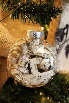 Simply cut strips of sheet music and place them inside clear craft ornaments.