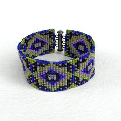 Colorful beaded cuff  beadwoven bracelet by Anabel27shop on Etsy,  #beadwork #crafts #handmade #ethnic