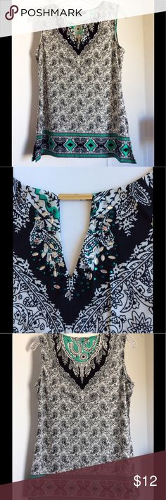 "Emerald Accents Top Perfect condition! Sleeveless & Sophisticated top with accents of Emerald color throughout. Jewel embellishments & gold tone bar at neckline (2nd pic). Reverse side has an eye catching pattern (3rd & 4th pics).  Machine Washable. SIZE: label says ""petite medium"" but fits like classic Small. Note last pic for shoulder-bottom length measurement. Ava & Grace Tops"