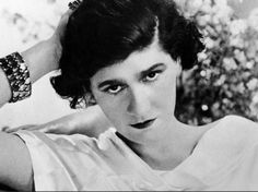"COCO CHANEL: Gabriell ""Coco"" Chanel was born in 1883 in France and spent her childhood in an orphanage where she was taught to sew by nuns. At 20 she opened her first shop in Paris and sold hats, was soon after making clothing, and by the 1920s launched Chanel No. 5 - the first perfume to feature a designer's name. In 1925, she introduced the now legendary collarless suit jacket and fitted skirt. She remained Chief Designer of her line until her death in 1971."