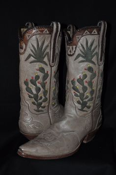 Vintage custom designed cowboy boots by TO Stanley. Made from camel leather, with inlaid cactus design.