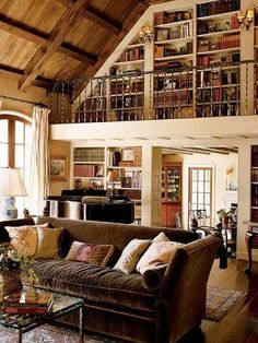 Mmm, rustic browns, exposed beams, loft, lots of books. Add a wrought-iron spiral staircase and we're set.