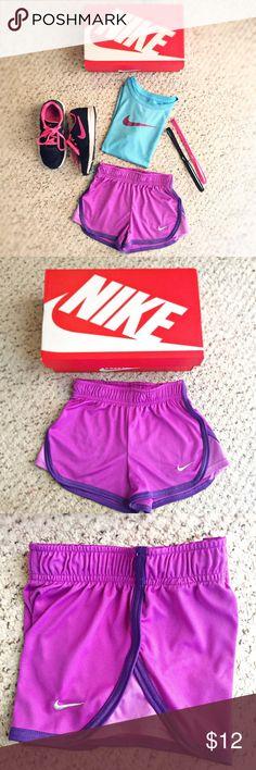 Nike girls running shorts size XS Nike girls running shorts size XS. Waistband strings, Dri-Fit, purple colored, great condition. Nike Bottoms Shorts
