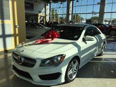 Love that they put the red bow on the top ❤️ 2015 CLA250 Mercedes Sport Edition