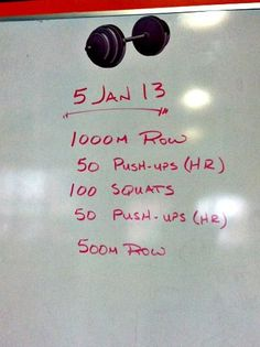 Crossfit WOD rowing workout with pushups and squats.