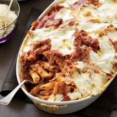 This hearty pasta dish is studded with chunks of Italian sausage and mixed with a quick garlic-infused tomato sauce. It's then topped with dollops of ...