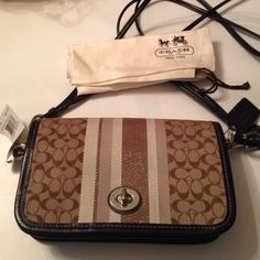 NWT Coach Bag Brand new never used.  Warm browns Coach Bags Shoulder Bags