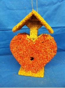 Cupid Heart Edible Birdhouse is twelve inches tall and full of love for all the wild birds!