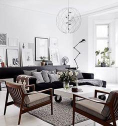 Black and white living room  #livingroomdecor #livingroom #interiordesign #interior #roomdecor #homedecor #cozyinteriors #elegantinteriors #50shadesofgrey #lighthome #woodenfloor #rug #decoration #lightinterior #scandinaviandesign #scandinavianstyle #scandinavianinterior #scandinavianelegance  #thelofs  #woodenfurniture #photoframedecorationthe_lofs