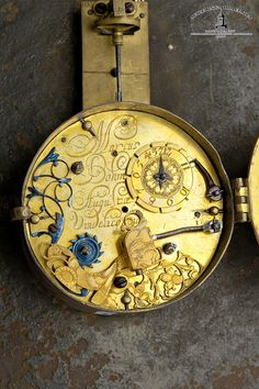 """Marcus Böhm in Augusta Vindelicorum (Augsburg), 370 x 265 mm, circa 1680 An Augsburg wall clock, a so-called """"Telleruhr"""", with hour self strike and front pendulum Case: gilt brass, rear bell. Dial: tin. Movm.: full plate movement, signed, verge escapement, 2 barrels, chain/fusee, applied large florally engraved count wheel, 1 finely engraved hammer. Marcus Boehm was born in 1650. He is mentioned as a member of the watchmakers' company in 1702. Boehm was one of the first clockmakers in…"""