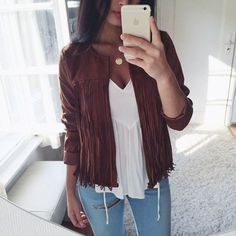 I'm really into the fringe jacket draped over the flowy top. This is something that a fit girl who happens to have a bigger bust could wear, be super fashionable, but still look modest. <3
