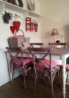 Handmade table with a lovely shaped top, also lovely the hatstand