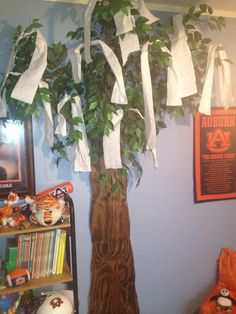 Toomer's Oak in grandson's room. Made from plywood and an old fake tree.  My mom made this!-Mary