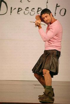 Gerard Butler... in a kilt... and a pink shirt... with a sword... because, yes.... :)