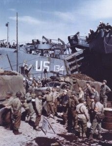 """Local Identifier: 111-SC-1247, """"Trucks which will carry supplies to front line troops when the assault against Hitler's Europe begins, are being loaded on an LST in a British port."""" (US National Archives)"""