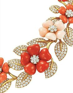 A SET OF CORAL AND DIAMOND 'ROSE DE NOEL' JEWELRY, BY VAN CLEEF ARPELS Found on jewelsdujour.com