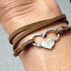 Horse shoe heart bracelet, sterling silver hand fabricated horseshoe heart with leather wrap. $36.00, via Etsy. For the horse lover that you know.